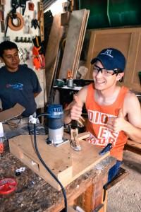 Paden and Pedro Jr w lens grinder